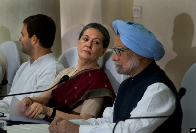 India's outgoing Prime Minister Manmohan Singh, right, Congress party president Sonia Gandhi, center, and her son and party vice president Rahul Gandhi, attend a meeting of the Congress Working Committee to review the party's defeat in the general election in New Delhi, May 19, 2014.