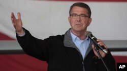 "FILE - Defense Secretary Ash Carter, shown speaking to U.S troops at the Incirlik Air Base near Adana, Turkey, Dec. 15, 2015, told members of the 101st Airborne Division that Islamic State ""is a cancer that's threatening to spread."""