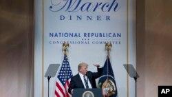 Le président Donald Trump lors d'un dîner du comité national républicain, à Washington, 21 mars 2017.