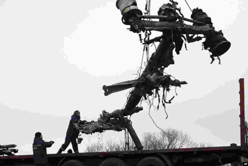 Recovery workers in rebel-controlled eastern Ukraine load debris from the crash site of Malaysia Airlines Flight 17 in Hrabove, Ukraine four months after the plane was brought down.