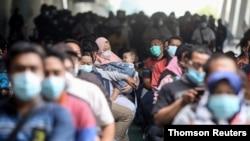 People wait for the COVID-19 vaccine at Juanda International Airport, as cases surge in Sidoarjo, East Java Province, Indonesia July 22, 2021. (Antara Foto/Umarul Faruq/via Reuters)