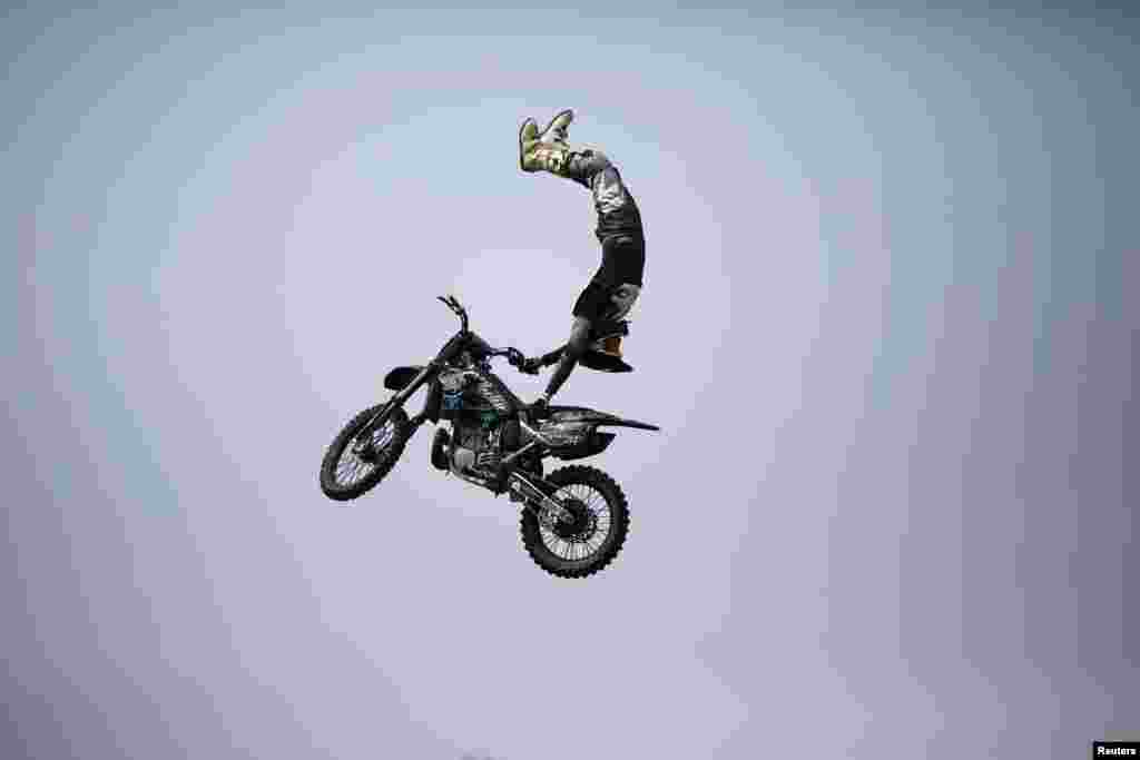 A competitor performs at the FMX Course competition during the World Extreme Games in Shanghai, China.