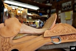 Nancy Martiny builds her saddles from the ground up, eventually carving and stamping designs into the leather.