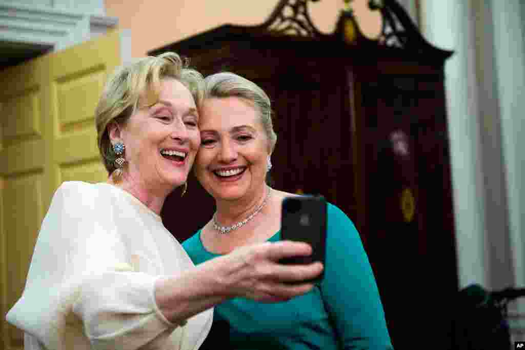 Actress Meryl Streep uses her iPhone to get a photo of her and Secretary of State Hillary Clinton following the Kennedy Center Honors gala in Washington, December 1, 2012.