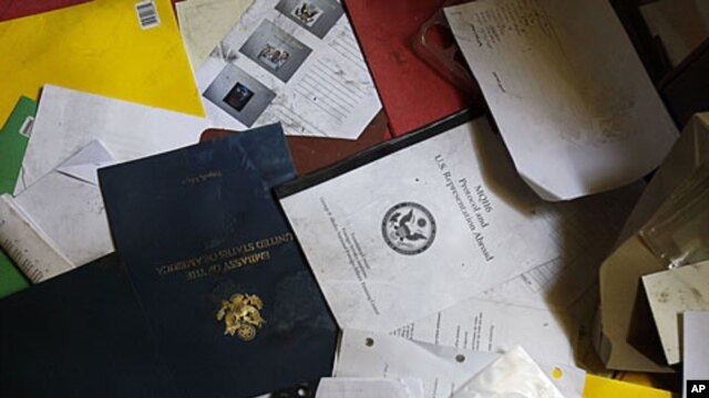 "A document reading ""MQ116 Protocol and US Representation Abroad"" is seen in the ransacked office of the US Ambassador and Deputy Chief of Mission during a visit for the press in the vandalized US Embassy in Tripoli, Libya, September 12, 2011."