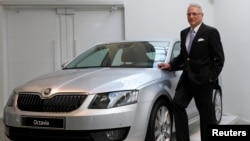 FILE - Skoda Chairman Winfried Vahland poses with a new Skoda Octavia car in this March 20, 2013 photo.