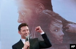 "FILE - Actor Hugh Jackman speaks during the Japan premiere of his film ""Logan"" in Tokyo, May 24, 2017."