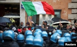 Restaurant and small-business owners take part in a protest calling for their businesses to be allowed to reopen, despite no authorization for the demonstration by the government, amid the coronavirus outbreak, in Rome, Italy, April 12, 2021.