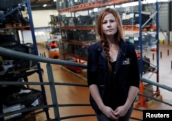 French apprentice Celine Galland, 31, poses in a training area at ''AFTRAL'', a transport and logistics training centre, in Savigny-le-Temple, France, Oct. 26, 2017.