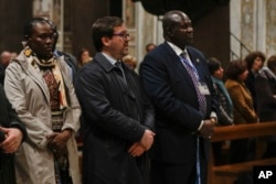 South Sudan Deputy-President Riek Machar, right, attends a prayer for peace event at the Basilica of Santa Maria in Trastevere, in Rome, April 11, 2019.