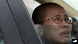 Liu Xia, wife of imprisoned Nobel Peace Prize winner Liu Xiaobo, cries in a car outside Huairou Detention Center where her brother Liu Hui has been jailed near Beijing.