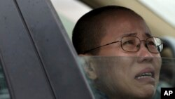 Liu Xia, wife of imprisoned Nobel Peace Prize winner Liu Xiaobo, cries in a car outside Huairou Detention Center where her brother Liu Hui has been jailed near Beijing.