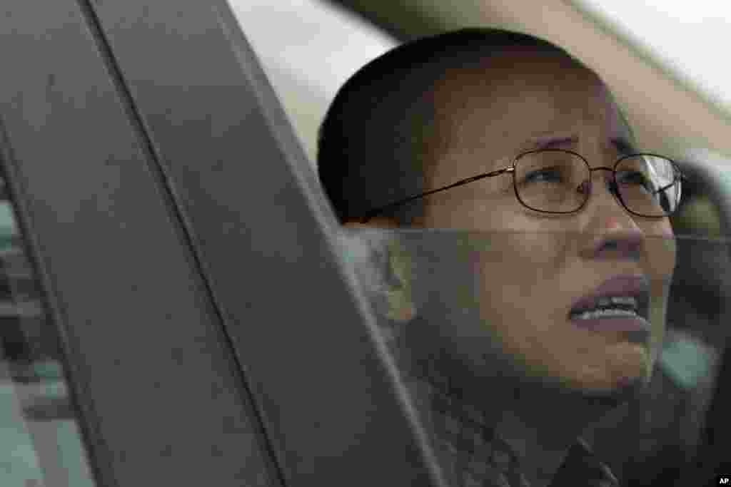 Liu Xia, wife of imprisoned Nobel Peace Prize winner Liu Xiaobo, cries in a car outside Huairou Detention Center where her brother Liu Hui has been jailed in Huairou district, on the outskirts of Beijing, China.