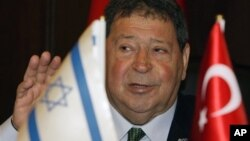 FILE - In this Nov. 24, 2009 file photo, Israel's Industry and Trade Minister Benjamin Ben-Eliezer speaks to the media with Turkish Defense Minister Vecdi Gonul, unseen, after signing a memorandum of understanding in Ankara, Turkey. Trade between Israel a
