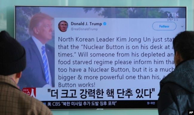 "People watch a TV news program showing the Twitter post of U.S. President Donald Trump in Seoul, South Korea, Jan. 3, 2018. Trump said that he has a bigger and more powerful ""nuclear button"" than North Korean leader Kim Jong Un."