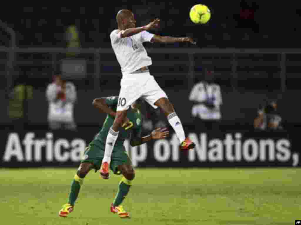 """Omar Daf (bottom) of Senegal challenges Ahmed Saad of Libya during their African Nations Cup Group A soccer match at Estadio de Bata """"Bata Stadium"""", in Bata January 29, 2012."""