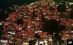 "FILE - Houses clutter a hillside in one of the many ""favelas,"" or impoverished neighborhoods, in Rio de Janeiro, Brazil, June 23, 1999."