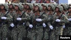 Việt Nam theo đuổi 'đường lối, chính sách quốc phòng mang tính chất hoà bình, tự vệ, thể hiện rõ chủ trương không sử dụng vũ lực hoặc đe doạ sử dụng vũ lực trong các quan hệ quốc tế, chủ động giải quyết tranh chấp chủ quyền lãnh thổ bằng các biện pháp hoà bình'.