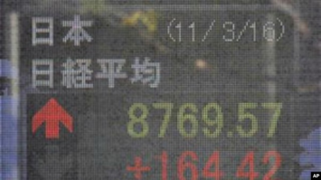 A man looks at the stock price board on a street in Tokyo, Japan, March 16, 2011