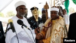 FILE - Kwire-Mana (R), receives his staff of office from Adamawa State Governor Murtala Nyako during a presentation ceremony at Makwada Square in Numan, Adamawa state, Dec. 7, 2013.