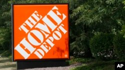 FILE - The sign showing the location of the Home Depot store in Cranberry, Pa.