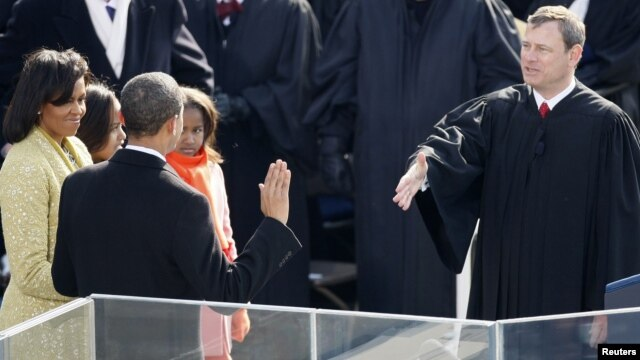 Barack Obama takes the Oath of Office as the 44th President of the United States as he is sworn in by U.S. Chief Justice John Roberts (R) during the inauguration ceremony in Washington, January 20, 2009.
