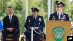 New NATO's Supreme Allied Commander Europe, U.S. Army General Curtis M. Scaparrotti delivers a speech as NATO Secretary-General Jens Stoltenberg, left, and former NATO's Allied Commander Europe U.S. General Philip M. Breedlove listen during a change of command ceremony at NATO military headquarters in Mons, Belgium, May 4, 2016.