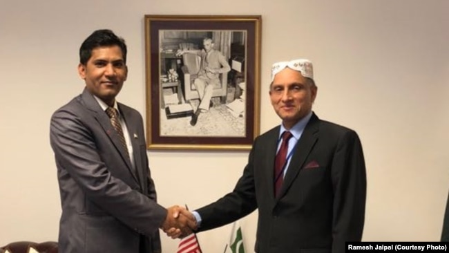 Ramesh Jaipal of Pakistan, who was sold into slavery as a child but later studied at American University's College of Law, meets with the Pakistani Ambassador in Washington, D.C.