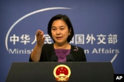 FILE - Chinese foreign ministry spokeswoman Hua Chunying gestures during a press briefing at the Ministry of Foreign Affairs building in Beijing, Sept. 15, 2017.