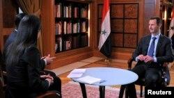 """Devletin kontrolundaki El İhbariye adlı televizyon kanalına konuşan Beşar Esat, kendi deyimiyle, """"Batı'nın el Kaide'ye verdiği desteğin sonuçlarının Avrupa ve Amerika'nın kalbinde"""" hissedileceğini söyledi."""