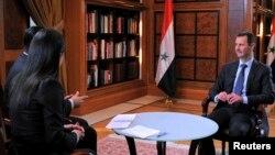 Ông Assad trả lời phỏng vấn trên đài truyền hình Al-Ikhbariya của nhà nước.