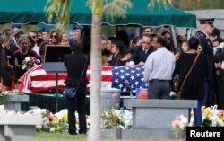 The flag-draped coffin of Marjory Stoneman Douglas High School student Peter Wang is seen at his burial service in North Lauderdale, Fla., Feb. 20, 2018.