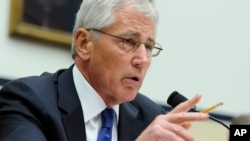 FILE - Defense Secretary Chuck Hagel testifies before the House Armed Services Committee on Capitol Hill in Washington, D.C.