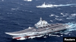 China's Liaoning aircraft carrier with accompanying fleet conducts a drill in an area of South China Sea, in this undated photo taken December 2016.