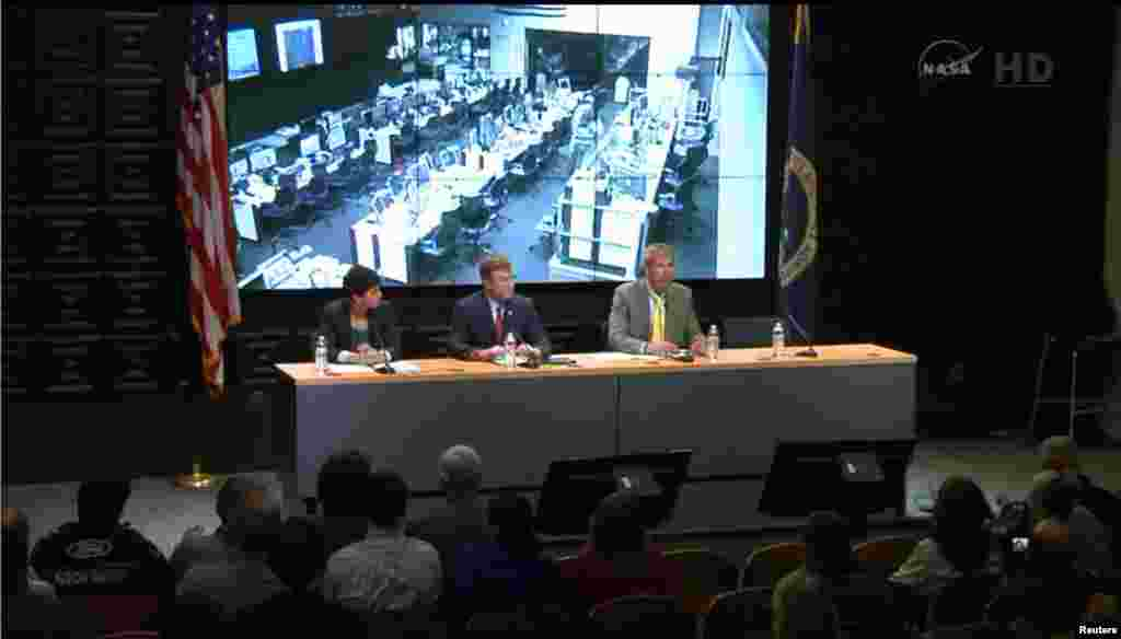 Rachel Kraft, NASA spokewoman, Frank Culbertson, Executive Vice President and General Manager of Advanced Programs Group at Orbital Sciences Corp., and Bill Wrobel, director of NASA's Wallops Flight Facility, speak at a news conference in this still image from NASA TV at Wallops Flight Facility, Virginia, Oct. 28, 2014.