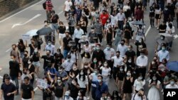 Protesters march during a flash mob protest in Hong Kong, Oct. 11, 2019.