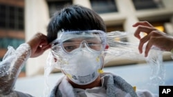 A Hong Kong pro-democracy protester covers his face in plastic wrap to protect against pepper spray in the event that it is used by the police, Sept. 29, 2014.