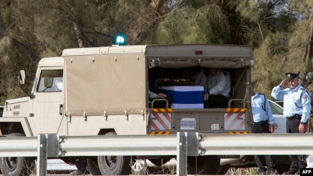 The convoy with the body of former Israeli prime minister Ariel Sharon's arrives at the grave site where his second wife Lily is buried, on Jan. 13, 2014 at the family ranch Havat Shikmin, near the Israeli city of Sderot in the southern Negev desert.