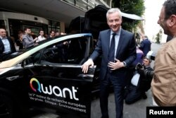 French Finance Minister Bruno Le Maire poses as he visits the new headquarters of search engine Qwant in Paris, June 14, 2018.