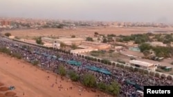People protest near the defence ministry building in Khartoum, Sudan