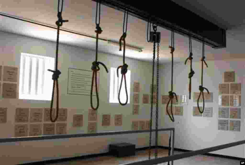In this photo taken Thursday, Dec 8. 2011, nooses hang in the gallows at the Pretoria Central Prison. The government opened the gallows, in Pretoria, South Africa, Thursday, Dec. 15, as a monument to those who were executed before being stopped in 1989