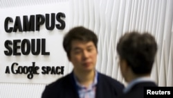People talk at the entrance to the Google Campus start-up space in the Gangnam district of Seoul.
