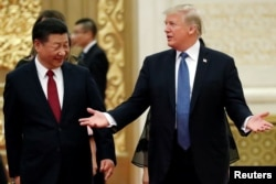 U.S. President Donald Trump and China's President Xi Jinping arrive for a state dinner at the Great Hall of the People in Beijing, Nov. 9, 2017.