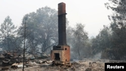 A chimney is all that is left of a home destroyed by the Detwiler fire in Mariposa, California U.S., July 19, 2017.
