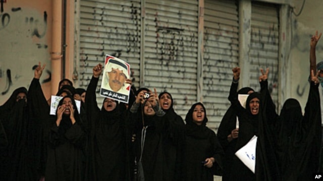 Bahraini women shout anti-government slogans in Sitra, August 31, 2011, during a demonstration shortly after the death of 14-year-old Ali Jawad Ahmad