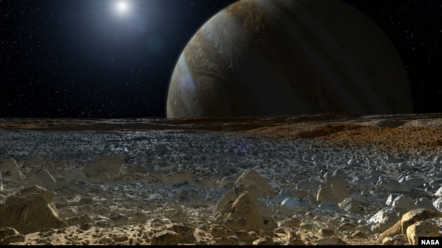 This artist's concept shows a simulated view from the surface of Jupiter's moon Europa. Europa's potentially rough, icy surface, tinged with reddish areas that scientists hope to learn more about, can be seen in the foreground.