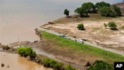 Aerial views shows a road that has been washed away by flood waters in Chokwe, Mozambique, January 30, 2013.