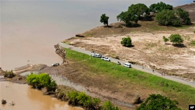Aerial views shows a road that has been washed away by flood waters in Chokwe, Mozambique, Jan. 30, 2013.