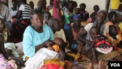 FILE - South Sudanese refugees wait at a health center in Maaji settlement, Adjumani district, northern Uganda, June 14, 2017. (H. Athumani/VOA)