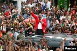 FILE - Kenya's President Uhuru Kenyatta addresses a Jubilee Party campaign rally in Nairobi, Oct. 23, 2017.